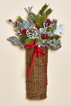 "16""H Willow Basket Featuring Frosted Greens, Red Berries, Pine Cones and a Red Bow"