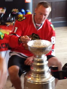 """Philip Pritchard @ keeperofthecup tweeted this photo of Blackhawks forward Marian Hossa on his day with the Stanley Cup:  """"Eating perogies out of the #stanleycup: Hossa style."""""""