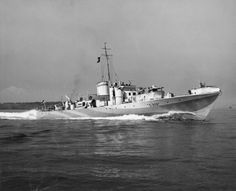 SEP 4 1943 Night Action in the Strait of Dover Steam Gun Boat, MGB S309, under the command of Lieutenant Commander Peter Scott underway at sea. S.309 was also known as 'Grey Goose'