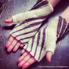 "Free Knitting Pattern: Windings Mitts  These ""garter stitch only"" mitts are constructed from two rhomboids - the thumb panel and a main part. Short row triangles in wind their way around your wrists creating a unique pattern."