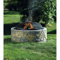 Living Accents® Stacked Stone Fire Pit - Outdoor Fireplaces - Ace Hardware Looks built-in for half the price and none of the work! $179.99