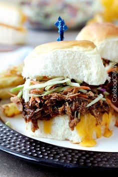 """Tender, tangy sweet, smokey, BBQ Pulled Pork perfect for large gatherings, busy weekdays or whenever you are craving the """"Best"""" BBQ pulled pork! If you are wondering why this post is lacking in my customary plethora of photos (sorry its my weakness, I can't just post a couple photos – I just love food and...Read More »"""