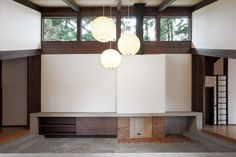 Japanese-Inspired Bainbridge Island house sloping roof above concrete hearth