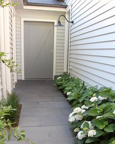 I wanted our garden to be an extension of the house's interior and something I love looking out on. I am sharing the details of our garden design including the plants and materials used. Patio Tiles, Outdoor Tiles, Outdoor Areas, Indoor Outdoor, Outdoor Living, Exterior House Colors, Interior And Exterior, Interior Design, Exterior Paint