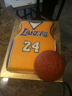 lakers cake - lakers jersey cake made of fondant, basketball made of cereal treats and molding chocolate