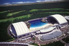 """The world's largest indoor swimming pool is located in Seagaia Resort - Japan. The """"Ocean Dome"""" has bagged the title of being the biggest indoor swimming pool Miyazaki, Amazing Swimming Pools, Indoor Swimming Pools, Oceans Of The World, Beaches In The World, Marina Bay Sands, Places To Travel, Places To Visit, Japan Beach"""