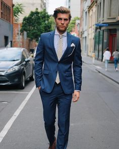 Foulard print tie and blue suit.