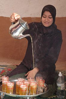 Morocca - tea is poured from a distance to produce foam on tea..
