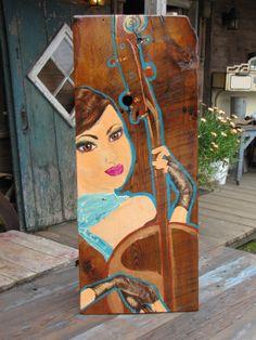 La musicienne Oeuvre sur bois centenaire 13 po par 32 par Leelooart, $300.00