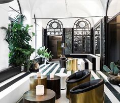Senato Hotel Milano - the furniture is striped to meet the lines of the striped marble floor - chic! Love the chairs in this hotel entrance