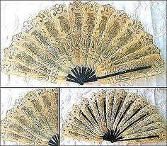 Gilded antique folding fan.