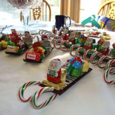 Candy sleds - made one for each of my nieces and nephews for Christmas last year.  I get the Santas and presents at CVS each year.  I use a tiny bit of hot glue to attach each wrapped piece of chocolate.