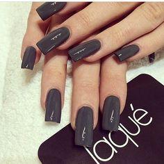 Long dark polished nails
