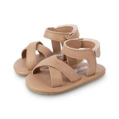 We think these are the perfect summer sandal and the gorgeous neutral color will pair perfectly with every outfit. The adjustable velcro fastening ensures they will be a perfect fit. These shoes support baby and toddler's feet for those long-awaited first steps. She smaller sizes have a roughed suede sole to prevent slipping, while the larger sizes feature a flexible rubber sole. Packaged in a cotton gift-bag with bell for the sweetest gift. See size chart HERE See our full collection of… Cute Baby Shoes, Baby Sandals, Toddler Sandals, Cotton Gifts, Summer Baby, Summer Shoes, Leather Sandals, Kids Fashion, Pairs