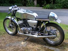 Cool Suzuki T 500 Cafe Racer with chrome body and spokes rims