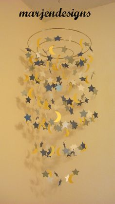 navy silver yellow and cream star and moon mobile, baby boy mobile, baby girl mobile, baby crib mobile, photo booth, baby shower gift by marjendesigns on Etsy https://www.etsy.com/listing/158950905/navy-silver-yellow-and-cream-star-and