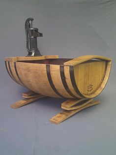 My own hand crafted design. Bespoke water feature/fish pond https://www.facebook.com/oakbarrelcreations.uk