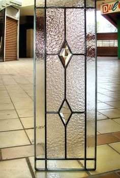 This six lite grid cabinet glass insert with a textured background and clear outer border creates a sparkling design with the two bevels.