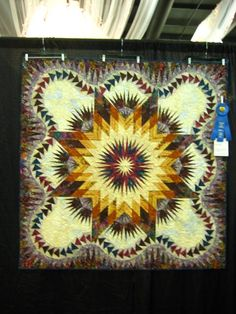 Dragon Star, designed by Quiltworx.com, made by Rosie Lysinger.  This quilt won a Blue Ribbon at the Bluegrass Quilt Show in Sheperdsville, KY.