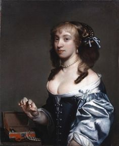 Gerard Soest (1600-1681) Portrait of a Lady seated at a table with a jewel casket