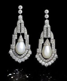 A pair of art deco natural pearl and diamond pendent earrings, circa 1925. Photo Bonhams