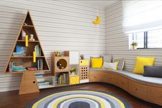 For a family with three kids, Hay fashioned a custom tree-like shelving unit that connects to a curvaceous, built-in sofa—ideal for lounging and reading. Yellow accents brighten up the restrained wooden palette. #dwell #howtodesignakidsroom #kidsroom #moderndesign #howto #diy #designtips Custom Made Furniture, Furniture Making, Contemporary Design, Modern Design, Built In Sofa, Modern Kids, Design Firms, Shelving, Lounge