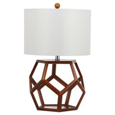 Cast a stylish glow over your bedside or favorite reading nook with this eye-catching table lamp, featuring an openwork wood base with a geometric silhouette...