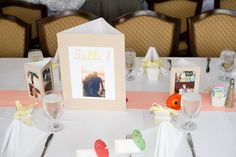 We used our engagement pics for our table numbers.  Also, instead of flower centerpieces, we used pictures of ourselves growing up with our families in tripod frames.  They were a big hit and our guests loved the walk down memory lane!