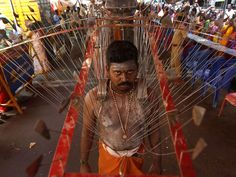 A Hindu devotee, with his body pierced with skewers,