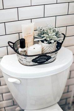 Home Decor Apartment Farmhouse bathroom decorating ideas - cheap farmhouse decor ideas for decorating your home on a budget.Home Decor Apartment Farmhouse bathroom decorating ideas - cheap farmhouse decor ideas for decorating your home on a budget Boho Bathroom, Master Bathroom, Bathroom Toilet Decor, Bathroom Baskets, Bathroom Vanities, Black Bathroom Decor, Farmhouse Decor Bathroom, Basement Bathroom, Bathroom Bin