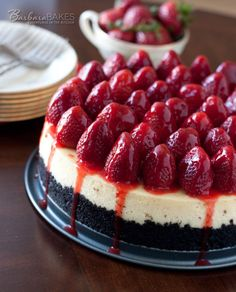 """Recent comment: """"Oh my goodness. BEST CHEESECAKE EVER! Literally! """" It's Strawberry season - what are you waiting for?Luscious, creamy New York style cheesecake with a crumbly Oreo cookie crust and topped with fresh strawberries drizzled with a strawberry glaze."""