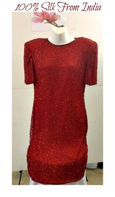 "Gorgeous new Consignment arrival! This is one beautiful dress that photos can not do justice! This is a red vintage dress made from 100% silk with a rayon inner lining. It is beaded throughout with lovely red embellishments. It is a size medium and made in India. The dress has a concealed zipper in back, is knee length, short sleeves and has the following measurements: 37"" Bust, 33"" Waist, 39"" Hips, 11"" Sleeve & 38"" Length.     This item ships immediately, and is also available for local try…"