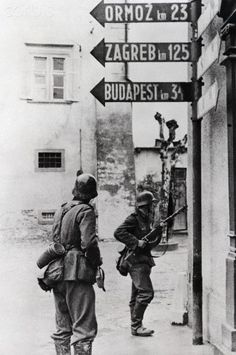 German Infantry in Yugoslav Town During World War II - BE033998 - Rights Managed - Stock Photo - Corbis