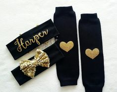 Check out this item in my Etsy shop https://www.etsy.com/listing/288069857/gold-and-black-sparkly-personalized-baby