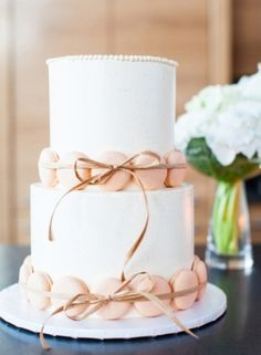 Rustic Wedding Ideas: Raffia ribbon and chic macarons make for the perfect shabby-chic wedding cake! via Snippet & Ink Photographed by Kate Webber Cake by Crisp Bakeshop