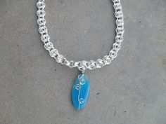 A personal favorite from my Etsy shop https://www.etsy.com/listing/231017860/chainmaille-necklace-with-blue-stone