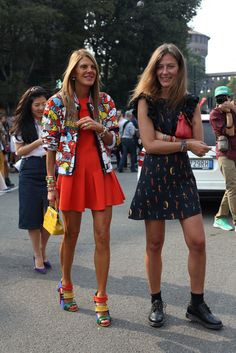 All the Best Street Style Straight From Milan Fashion Week!: Not-so-mellow yellow with a few high-impact add-ons to boot.: Anna Dello Russo was rainbow-bright perfection, while her showgoing companion kept it cool in a printed dress and tough-girl footwear.