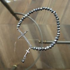 Francesca's Collections Silver Cross Bracelet Francesca's Collections Silver Rhinestone Cross Stretch Bracelet. Never worn! Cute little cross charm and bead attached. Francesca's Collections Jewelry Bracelets