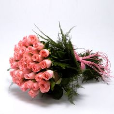 "Tight bunch of 30 long stem #pink #roses nicely wrapped with lots of fillers and tied with pink #ribbon bow.(Please read ""Delivery Information"" and ""Other Information"" before ordering.)"