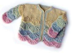 The scallop & lace pattern is simple yet rewarding to knit. Choose between solid or multiple colors, and button or zipper closure. A lightweight elastic yarn will hold the pattern's shape better than other materials.