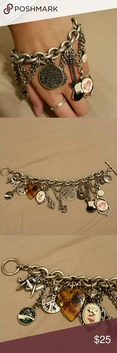 Lucky brand Charm Bracelet This item features a bracelet by Lucky Brand. It is made using silver tone metal with an antique finish. This bracelet is HIGH QUALITY. It may be hard to tell from the pictures however, when seen in person, the bracelet looks anything but cheap!  There are a ton of details on this bracelet: fleur-de-lis, airplane, 5 Hawaii related charms, peace sign, guitar pick, guitar with actual strings made of gold wire (so rich looking), 2 four leaf clover charms, and more…