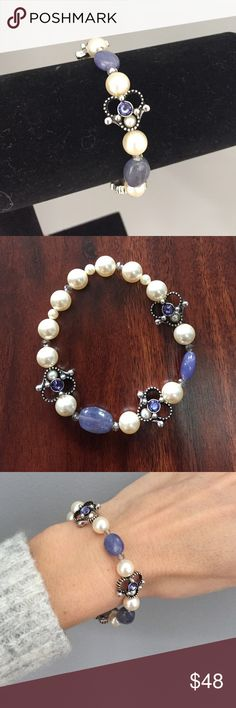 "⭐️ Genuine tanzanite and Swarovski bracelet ⭐️ Stunning genuine tanzanite focal beads with Swarovski tanzanite crystal and silver flower accents. Cream Swarovski pearls (2mm and 8mm) encircle the wrist with tiny gray crystal accents. Gorgeous one of a kind piece from Julie's Bead Boutique. Stretch, 7"". Jewelry Bracelets"