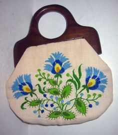 Vintage Needlepoint  Hand Embroidered Flowers Frame Hand Bag Purse Wood Handle by backtocapri on Etsy https://www.etsy.com/listing/18044926/vintage-needlepoint-hand-embroidered