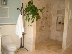 Great shower! I like the idea of using a coat rack to hang your bathroom towels.