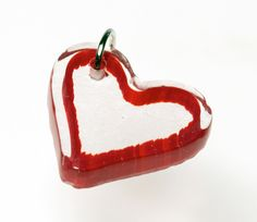 Check out my good friend Nadine Sayor's jewelry on Etsy... she's a professor of glass at BGSU and a rockin' sculptural glass artist. glass heart pendant by naynaysay on Etsy, $25.00