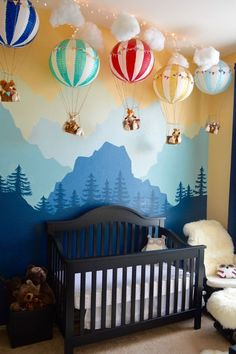 Whimsical Woodland Nursery Bedroom Design - love this gorgeous mountain forest wall mural art + hot air balloon decor!