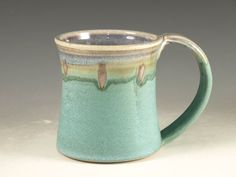 Large Mug Cup with Large Handle - turquoise (20oz) -- Perfect for Hot Chocolate  This white stoneware mug is thrown on the pottery wheel. I glazed this mug with the rutile blue glaze inside and overlapping outside with the turquoise glaze with hint of red/pink dots. The mug is reduction fired to cone 10 in the gas kiln. I mix own lead and barium-free glaze.  The mug holds 20 oz and has a large handle. It is food safe, dishwasher and microwave safe. Enjoy!  Size 4.5 high, 4 wide and 6 dee...