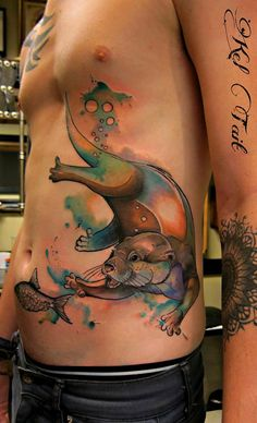 Otter Chasing a Fish Tattoo - http://giantfreakintattoo.com/otter-chasing-a-fish-tattoo/