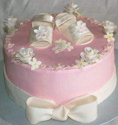 baby shower cakes for girls (GREAT idea, I have a shower coming up so I need PLENTY of ideas. I'm thinking something like this, but with real baby shoes on top..hmm?)