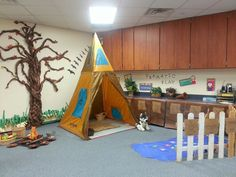 """This month's dramatic play theme for our kindergarteners was """"Native American Village."""" We had a pond for them to fish, a campfire, and even a little pumpkin garden."""